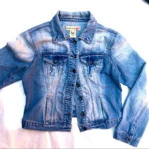 Distressed jean jacket. Women's size large.